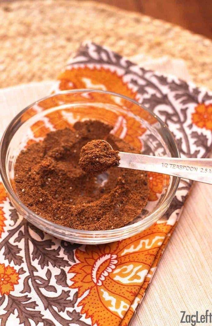 Garam masala on a measuring half teaspoon