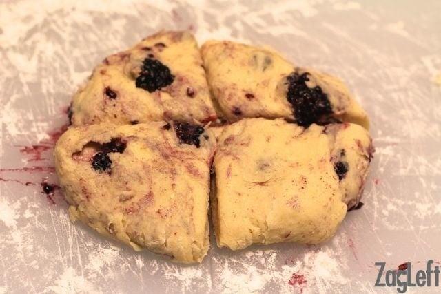Slicing berry scones into four pieces