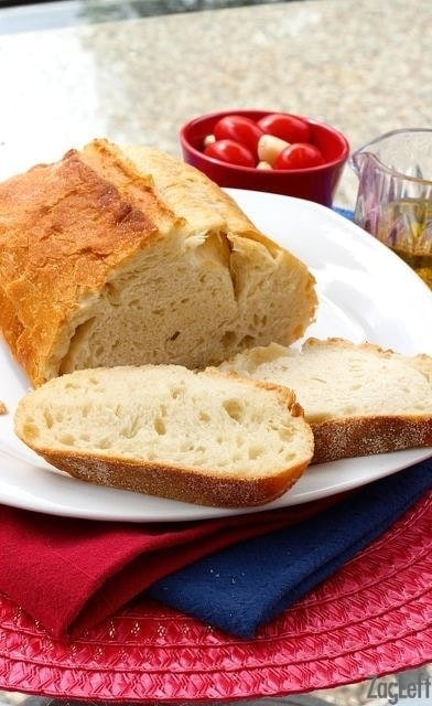 Loaf french bread with two slices on a plate