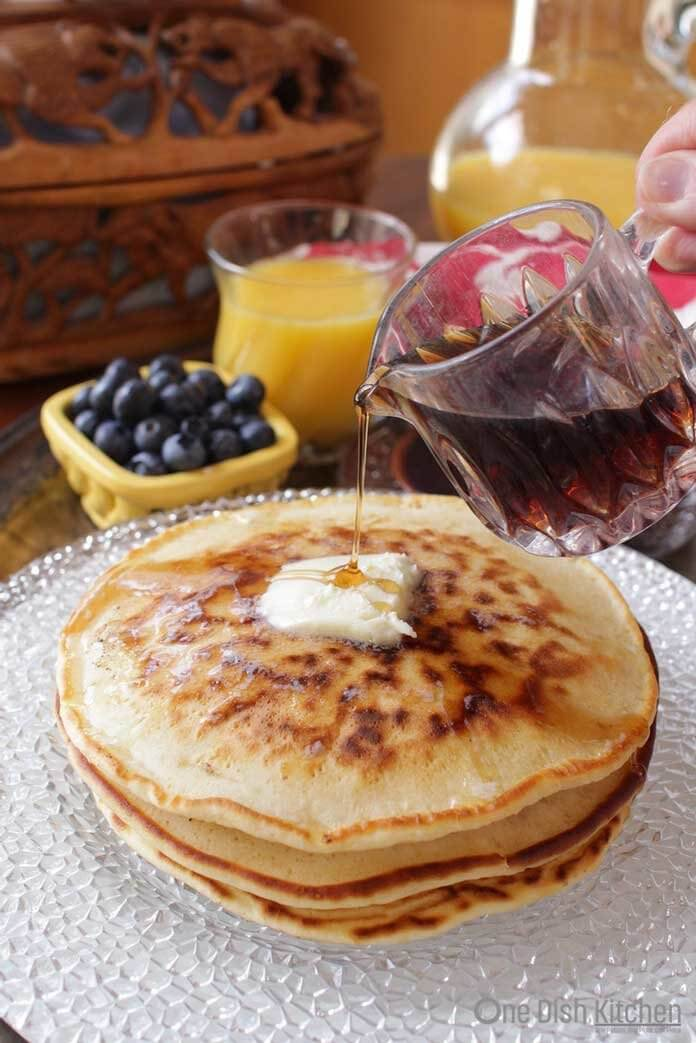 pancakes on a plate with syrup drizzle