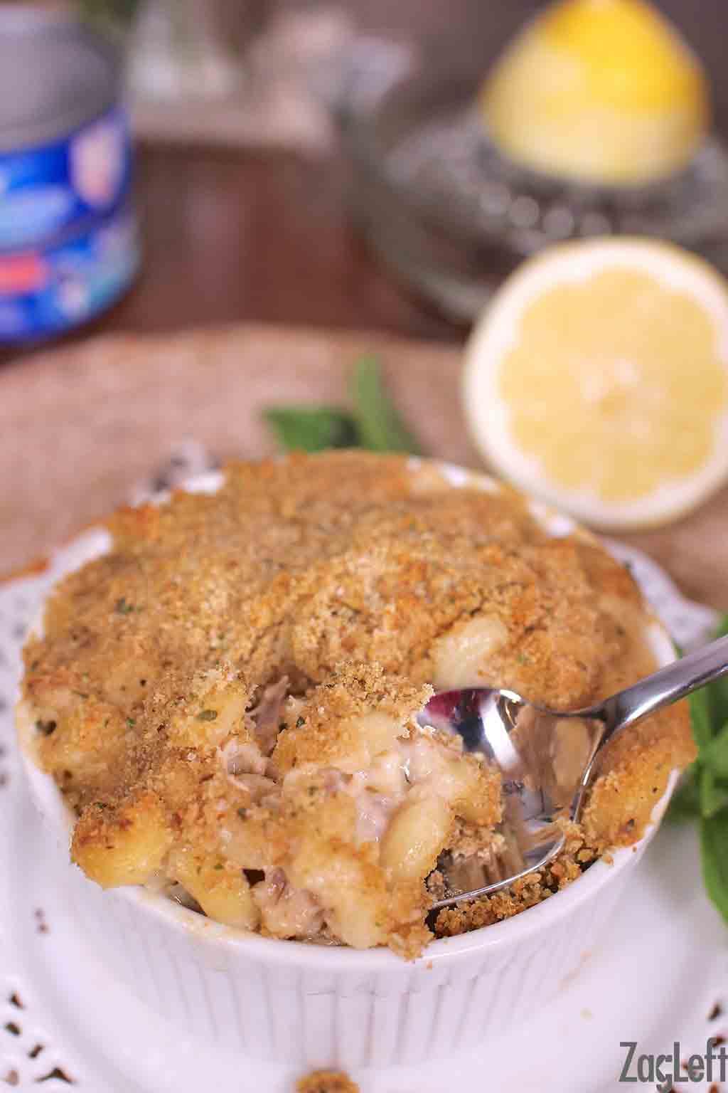 A closeup of a spoonful of tuna casserole in a small bowl