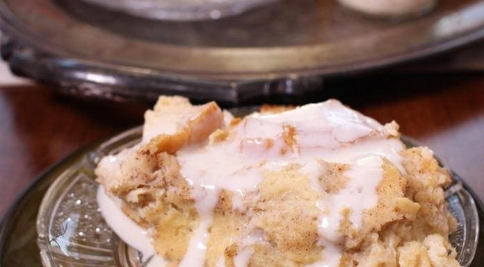 Traditional New Orleans Style Bread Pudding made with French bread, milk, eggs, sugar and spices served with a rich and creamy Whiskey Sauce...| One Dish Kitchen