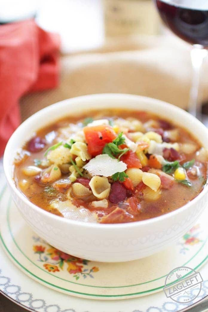 Minestrone Soup Recipe For One - this hearty Italian soup is filled with vegetables, beans, bacon and pasta. It's a flexible single-serving recipe that can be made with any number of your favorite vegetables and ingredients. | One Dish Kitchen