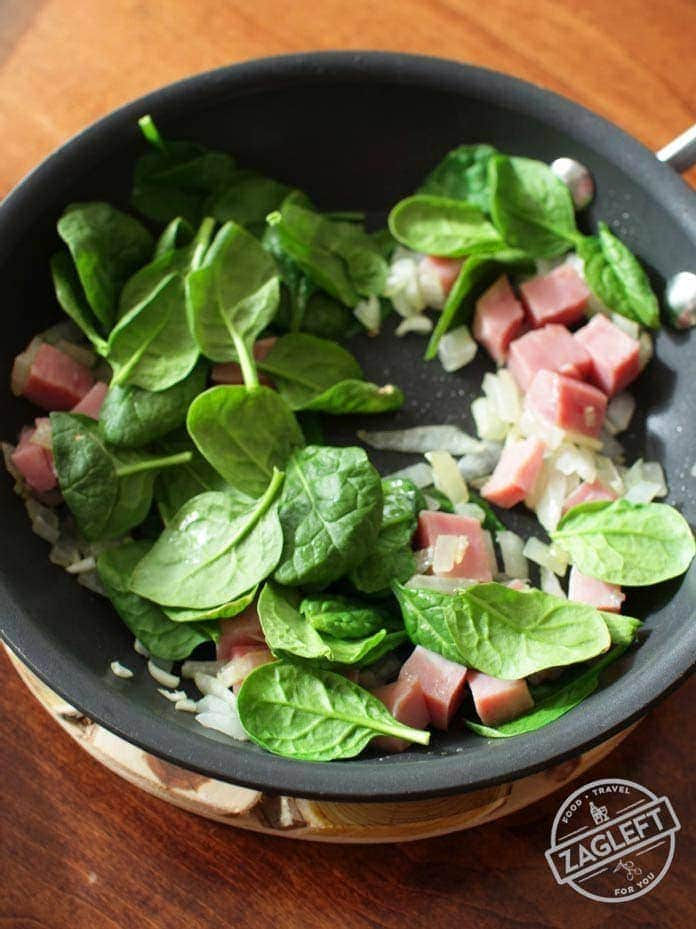Cooking spinach and ham together for a Crustless Spinach Quiche| One Dish Kitchen