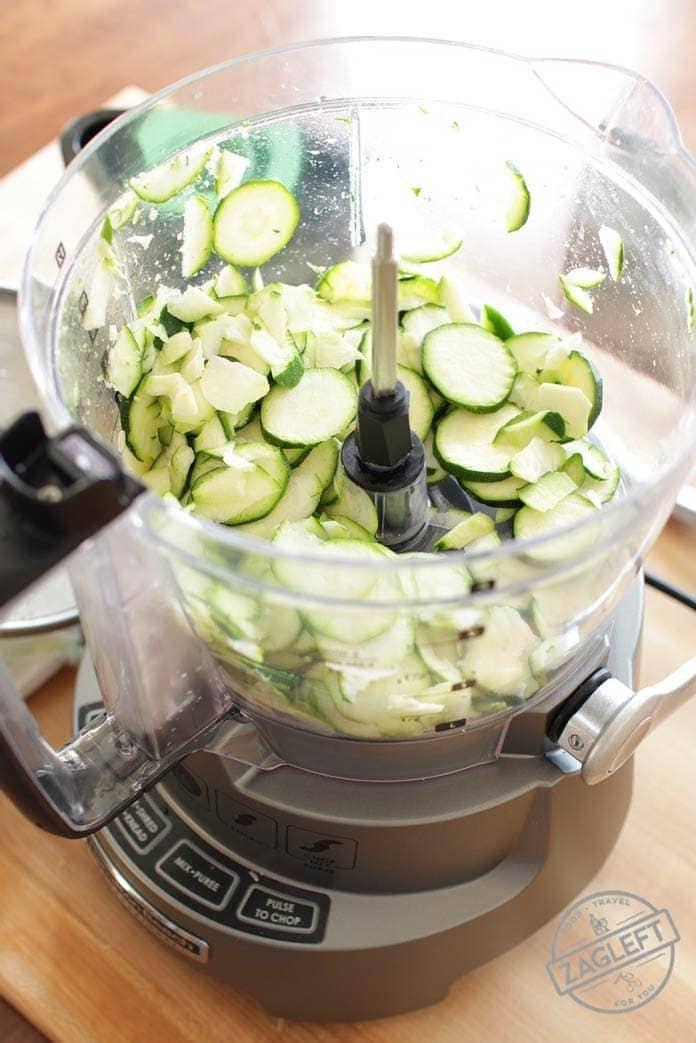 Sliced zucchini in a food processor