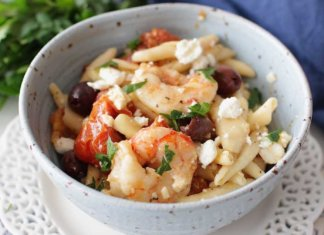 Quick and easy Mediterranean Shrimp and Pasta For One, a hearty and flavorful single serving meal filled with juicy shrimp, oven roasted tomatoes, salty Kalamata olives and creamy Feta cheese. The perfect amount if you're cooking for one. | One Dish Kitchen