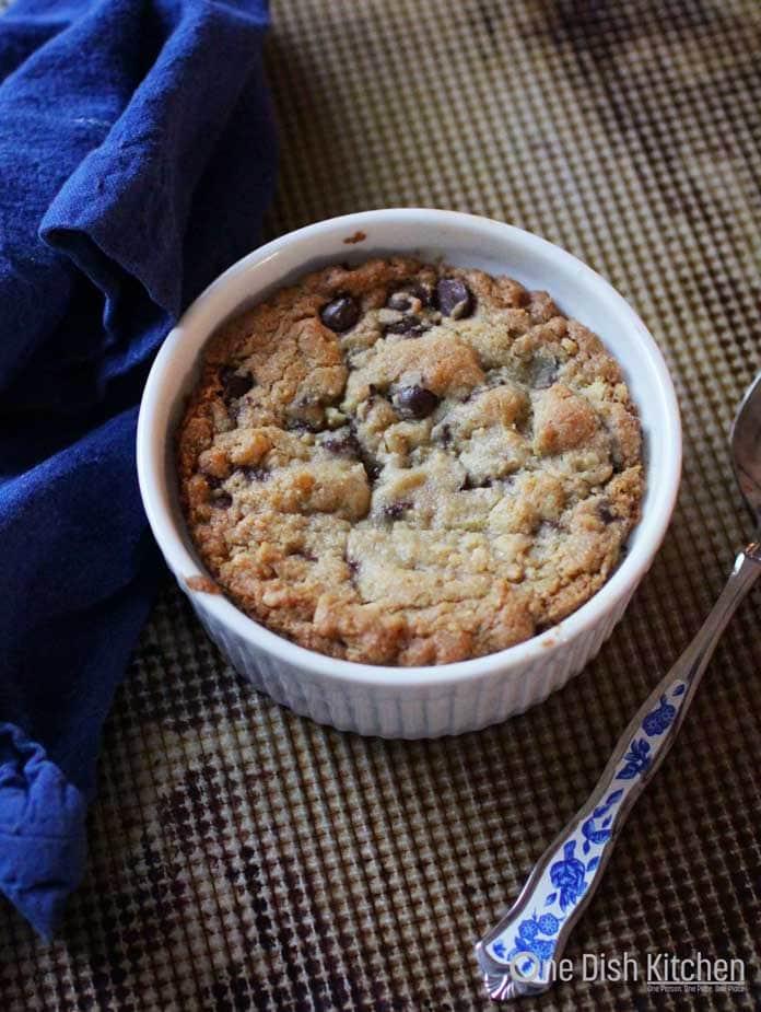 deep dish chocolate chip cookie in a ramekin