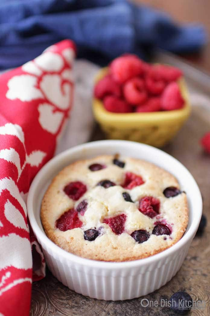 This buttery, berry topped coffee cake recipe is ideal for times when you'd like a little something sweet. Easy to make and the perfect size for one person. Perfect for breakfast or dessert and will surely satisfy a sweet tooth. | One Dish Kitchen