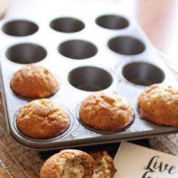 4 banana muffins in a muffin tin.