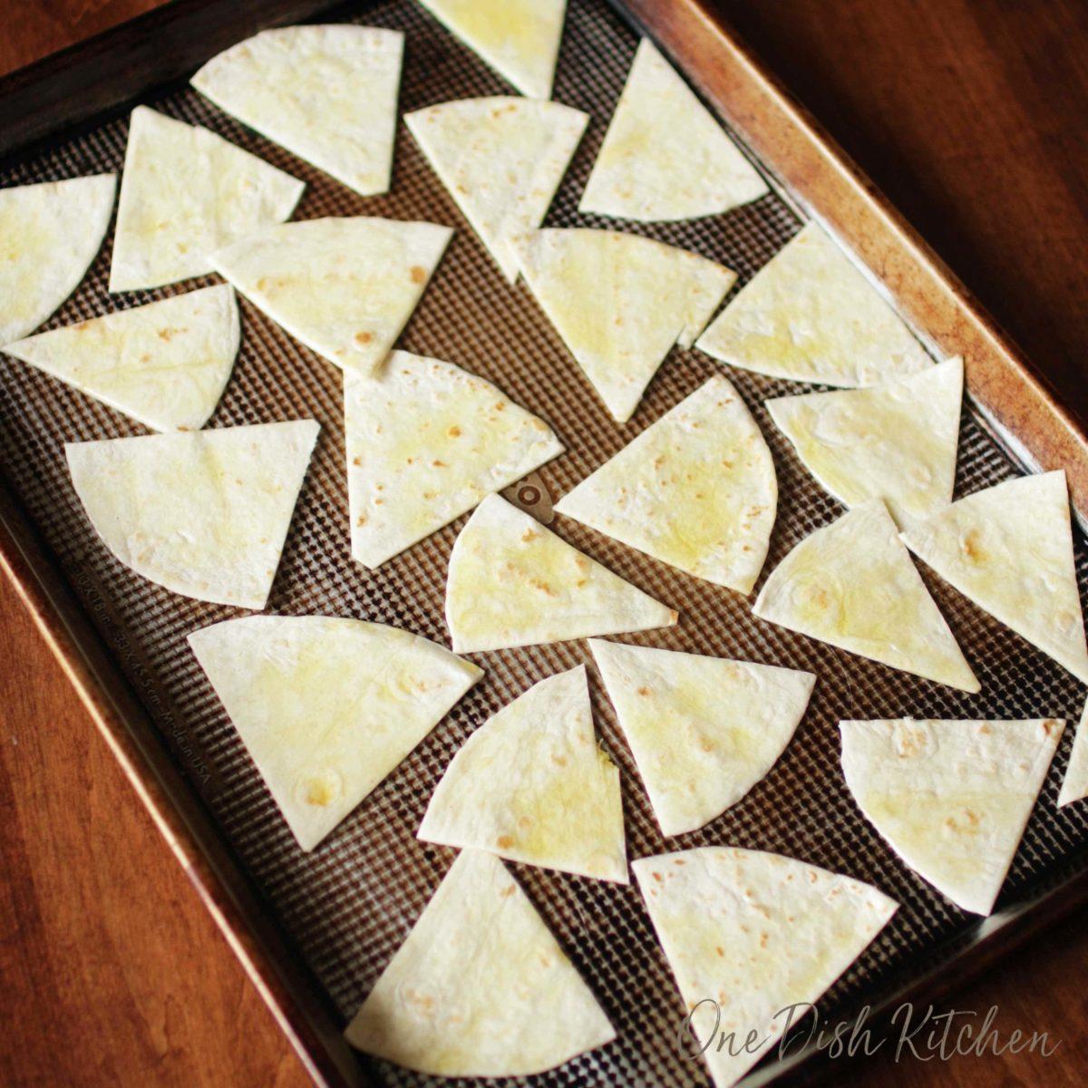 cut tortillas on a baking sheet.