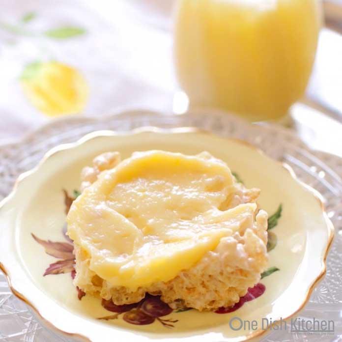 Lemon curd spread over a rice krispie treat