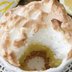 lemon meringue pie with a bite taken out.