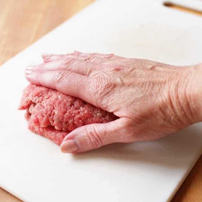 hamburger patty being pushed down