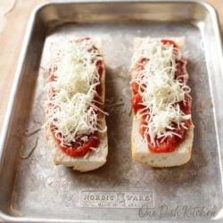 adding mozzarella cheese to french bread for a french bread pizza   one dish kitchen