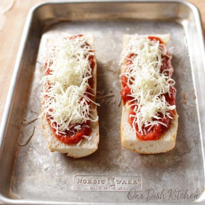 adding mozzarella cheese to french bread for a french bread pizza | one dish kitchen