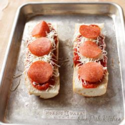 adding pepperoni slices to french bread for a french bread pizza   one dish kitchen