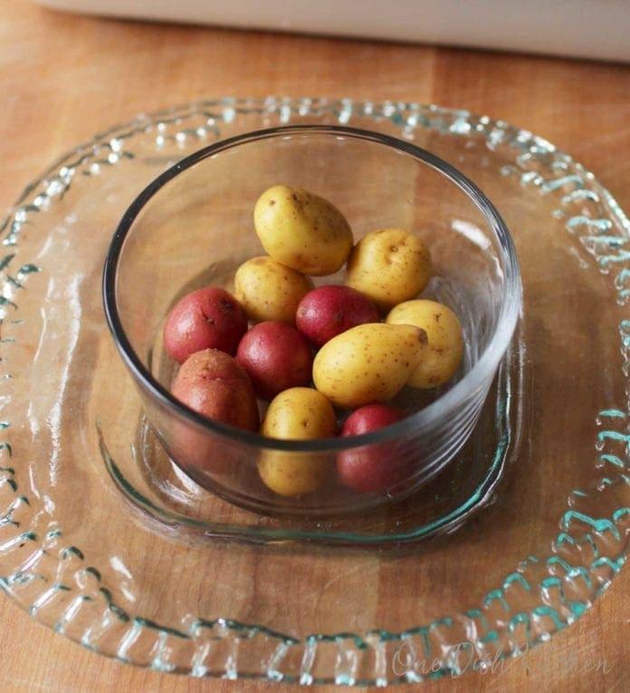 bowl of baby potatoes for smashed potato recipe   one dish kitchen