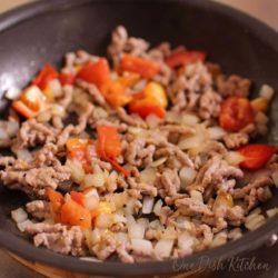 ground pork cooking in a skillet | unstuffed cabbage rolls | one dish kitchen