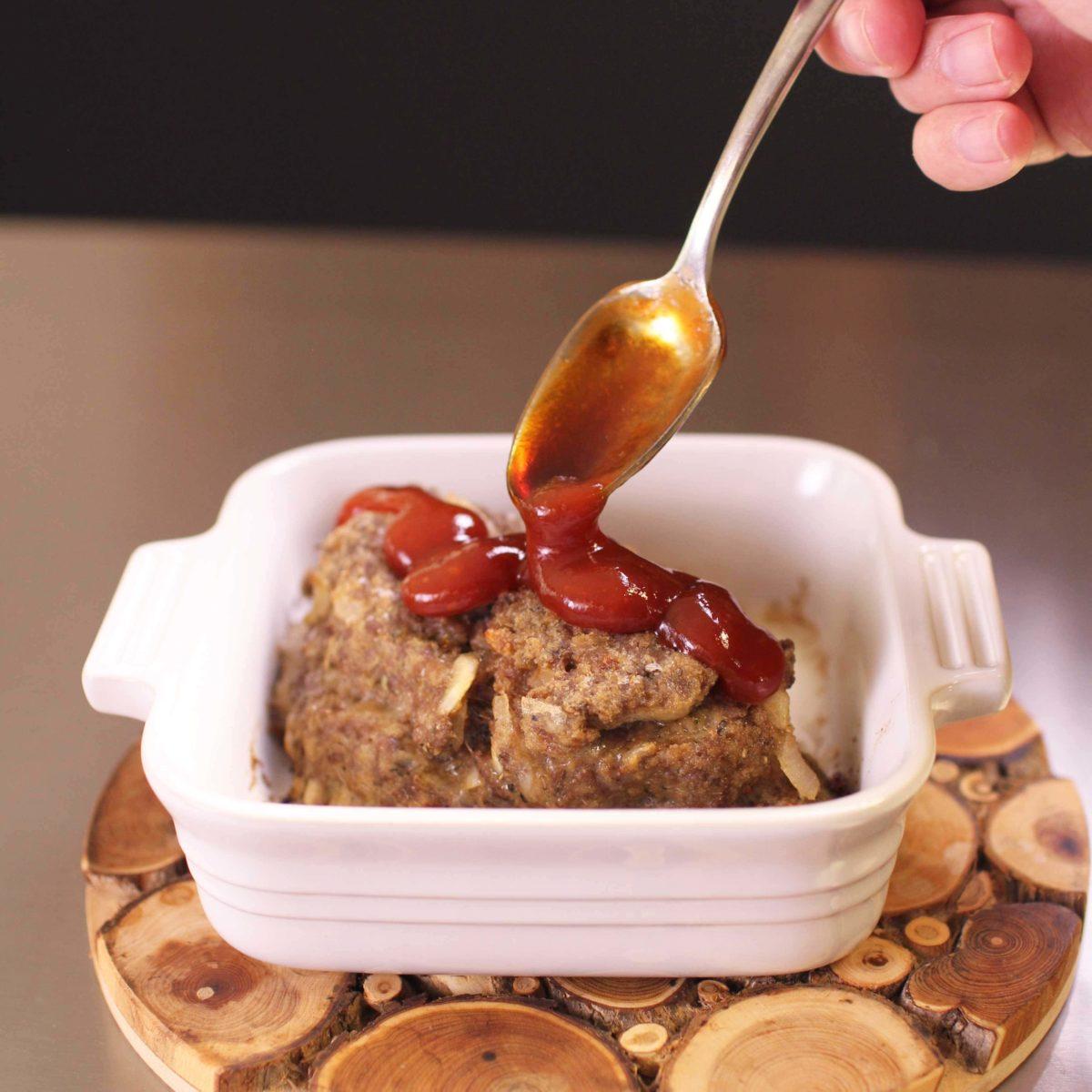 spooning glaze over meatloaf