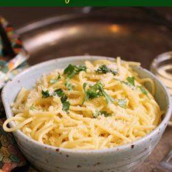 butter noodles in a ligh blue bowl