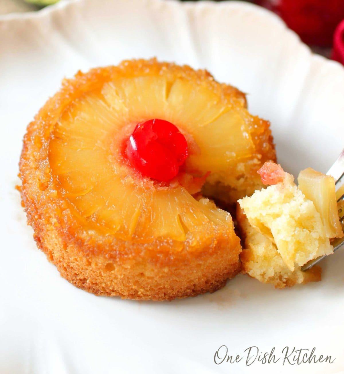 a closeup of a partially eaten pineapple upside down cake.