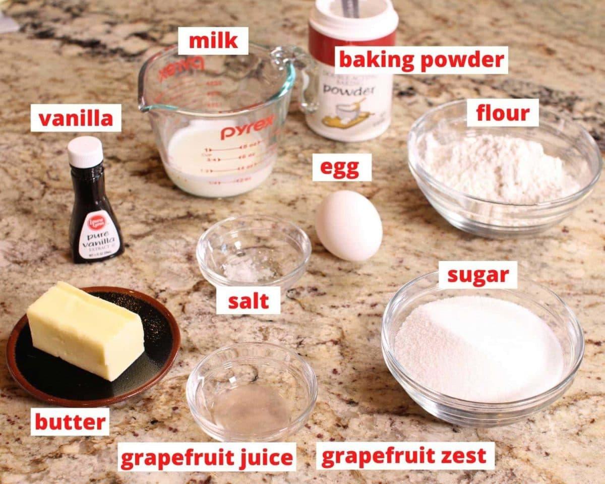 butter, flour, egg, vanilla, salt, sugar on a granite counter.